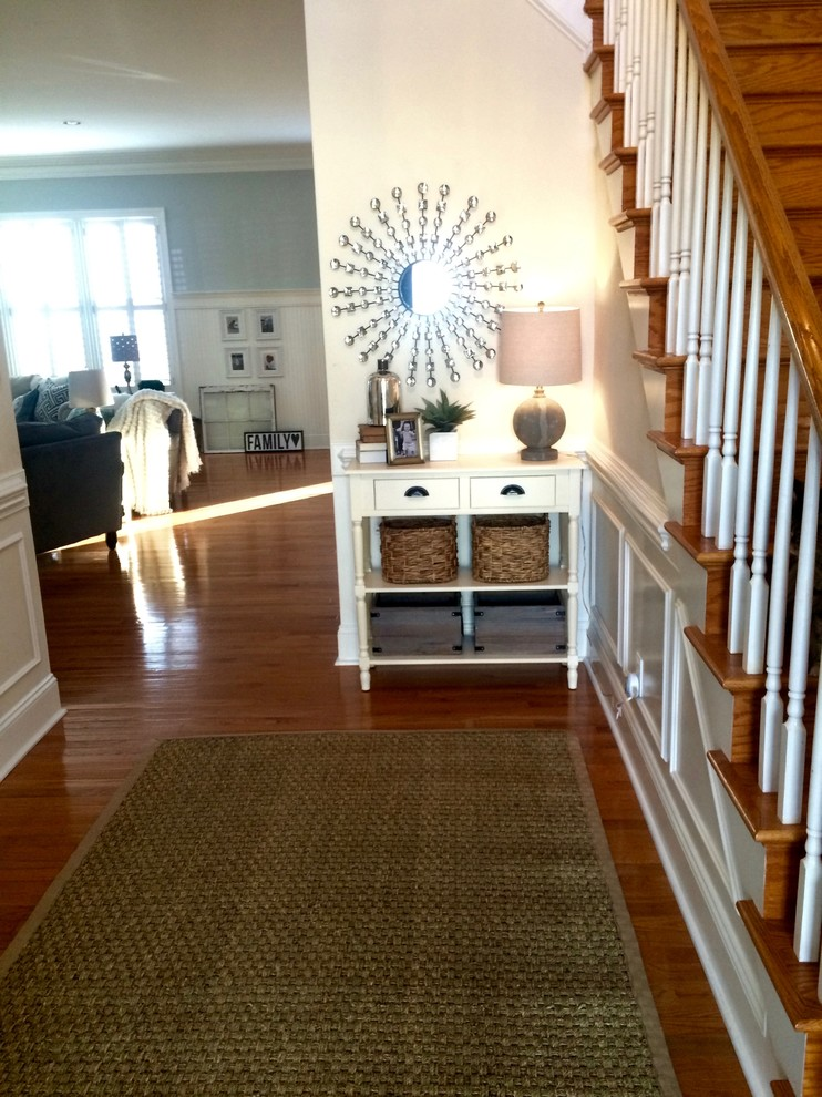 Example of a mid-sized transitional medium tone wood floor and brown floor entry hall design in Charlotte