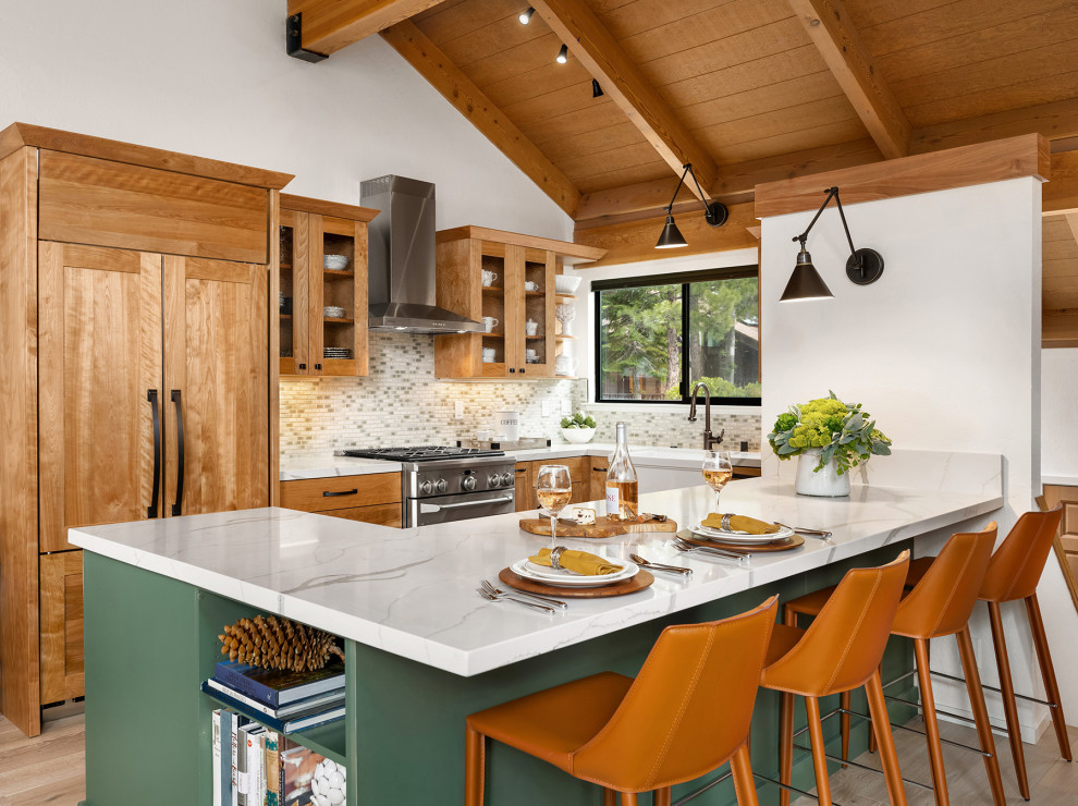 Mid-sized mountain style u-shaped light wood floor, beige floor and exposed beam open concept kitchen photo in Other with a farmhouse sink, shaker cabinets, green cabinets, quartz countertops, green backsplash, porcelain backsplash, paneled appliances, a peninsula and multicolored countertops