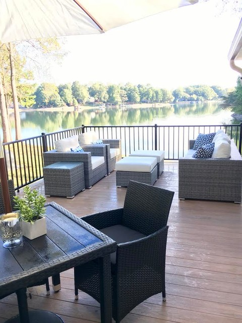 Example of a mid-sized transitional backyard deck design in Charlotte with no cover
