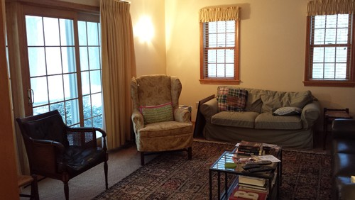 Dated gold carpet and curtains, unpainted wood and bright brass every