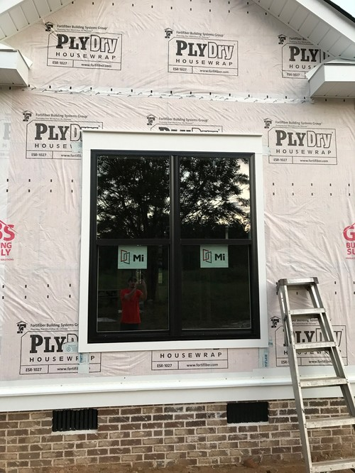 once the siding was on however the vinyl trim that was installed around the composite trim was even or stuck out from it making it look recessed and made