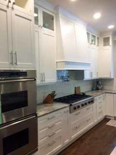 Large Kitchen with White Cabinets and Stained Island