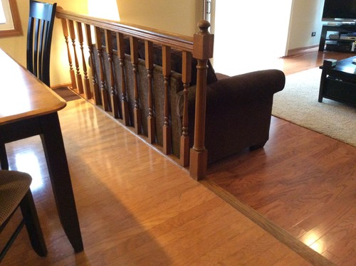What to do with railing and step down into family room..