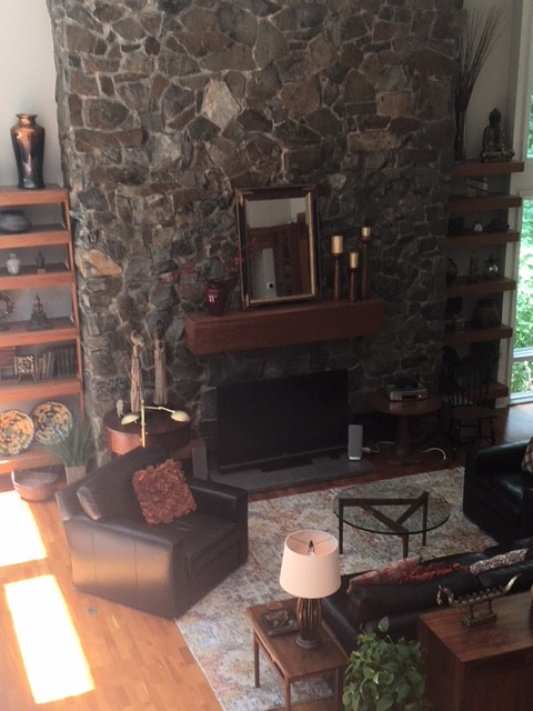 Two Story Wall of Windows and Massive Stone Fireplace Family Room