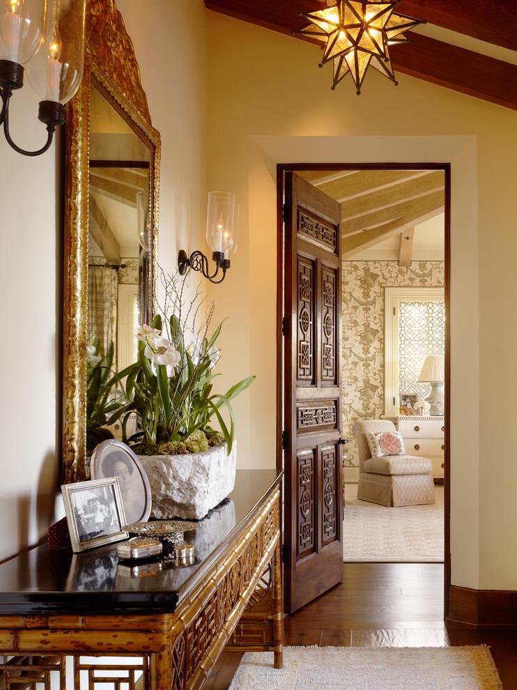 Hallway - traditional dark wood floor hallway idea in San Francisco with beige walls