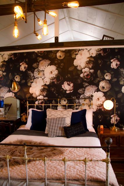 Bedroom - large country master dark wood floor and brown floor bedroom idea in Austin with white walls