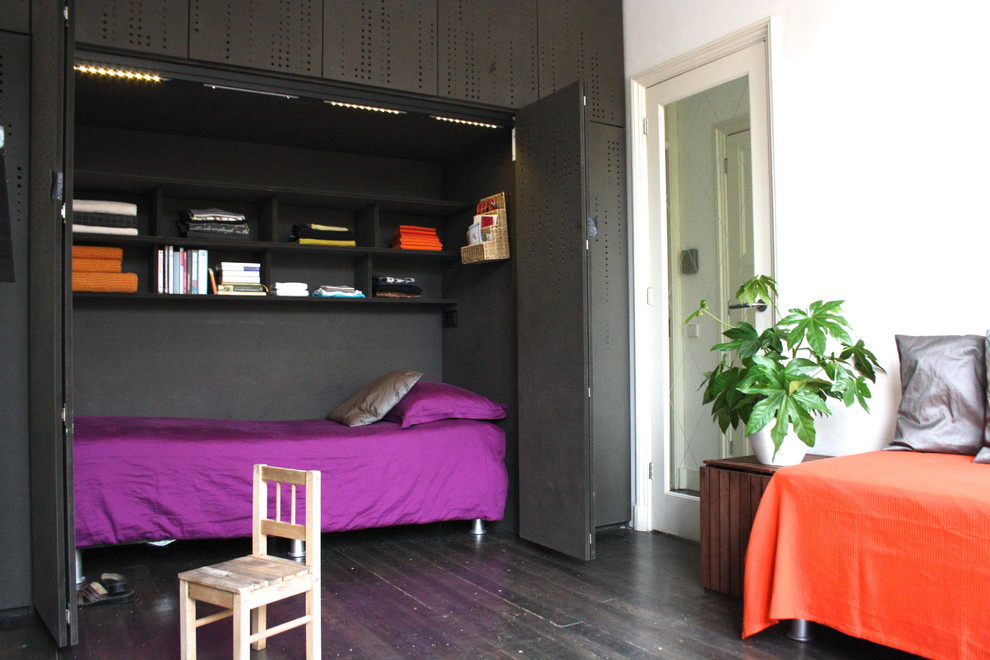 Inspiration for a contemporary gender-neutral dark wood floor kids' room remodel in Amsterdam with multicolored walls