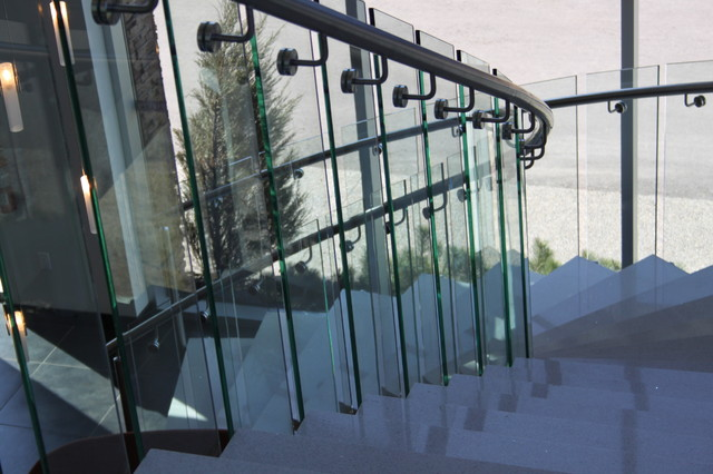 Perfect Granite Treads With Curved Railings And Glass Panels Modern Staircase