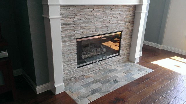 Custom Surface Solutions (www.css-tile.com) - Owner Craig Thompson (512) 430-1215. This project shows a redone fireplace from Absolute Black granite tiles and