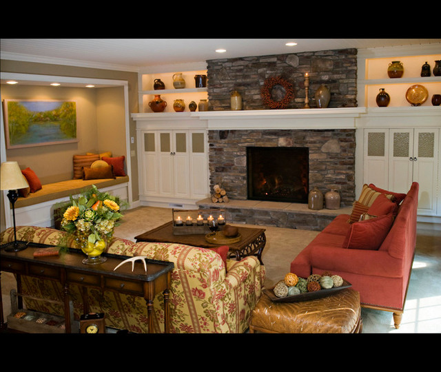 Family room - country carpeted family room idea in Other with a standard fireplace, a stone fireplace and a media wall