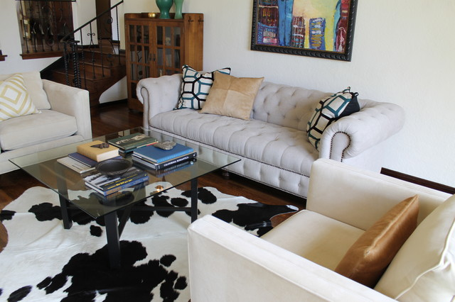 Linen Chesterfield Sofa Glass Cocktail Table and Cowhide Rug