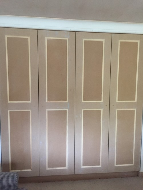 painting newly made fitted wardrobes