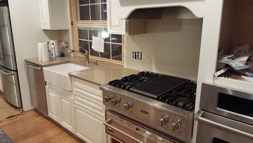 Kitchen backsplash applied to cabinets - Stove backsplash protector ...