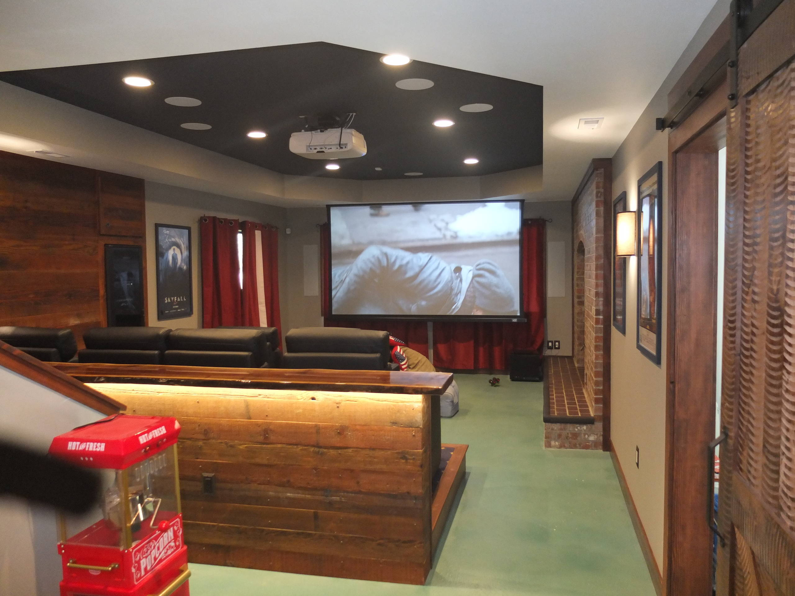 Mid-sized mountain style open concept blue floor home theater photo in Seattle with beige walls and a projector screen