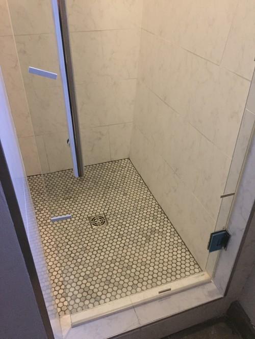 & Gap in frameless glass shower door