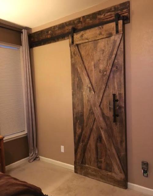 Sliding Barn Door Header In Master Bedroom Rustic Interior
