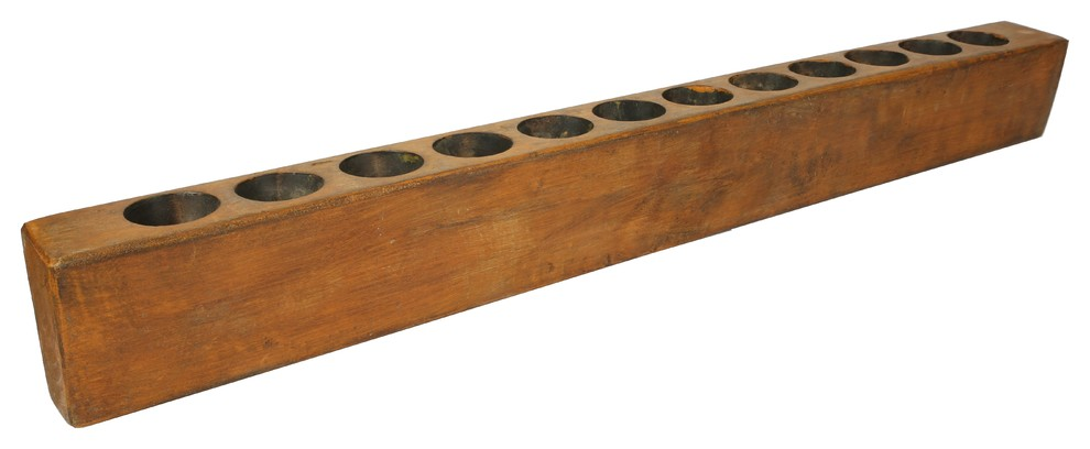 Four Hole Sugar Mold on Iron Stand