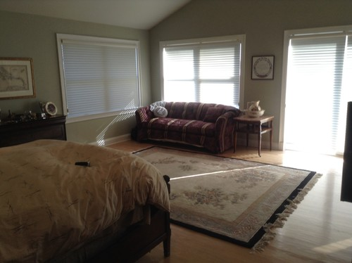 rug  and bedding can go but we want to keep the other furniture  The  walls were recently painter a sage color  Any ideas welcome for the empty  space. Need help with empty space in master bedroom