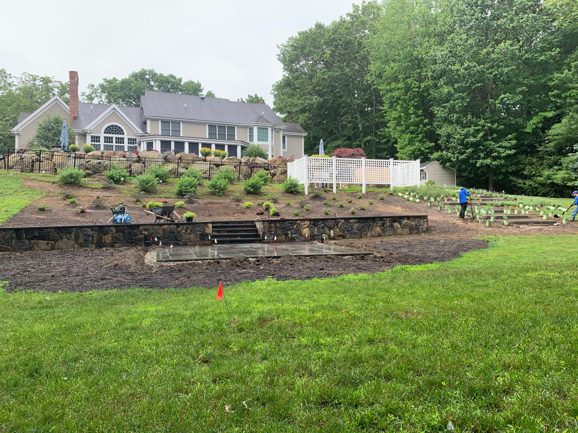 Starting to Plant the slope on this Pound Ridge Home