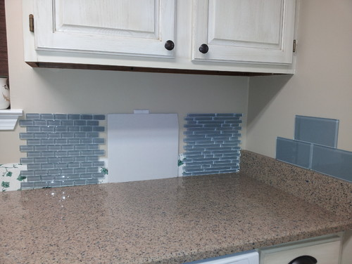 I have wall that extends beyond my counter/cabinets, how to edge the  backsplash here? I\'m using glass mosaic on mesh backing. please help! thank  you!