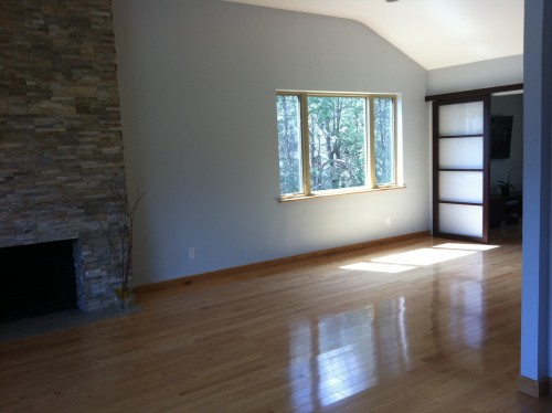 Furniture Layout Around Tall Fireplace In An L Shaped Living Dining Combo