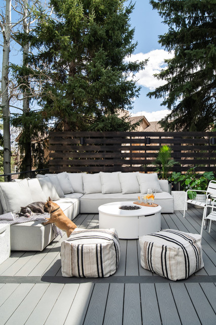 deck with cozy cushions on the outdoor sofa