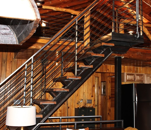 Steel floating stair case wrapped with Reclaimed wood
