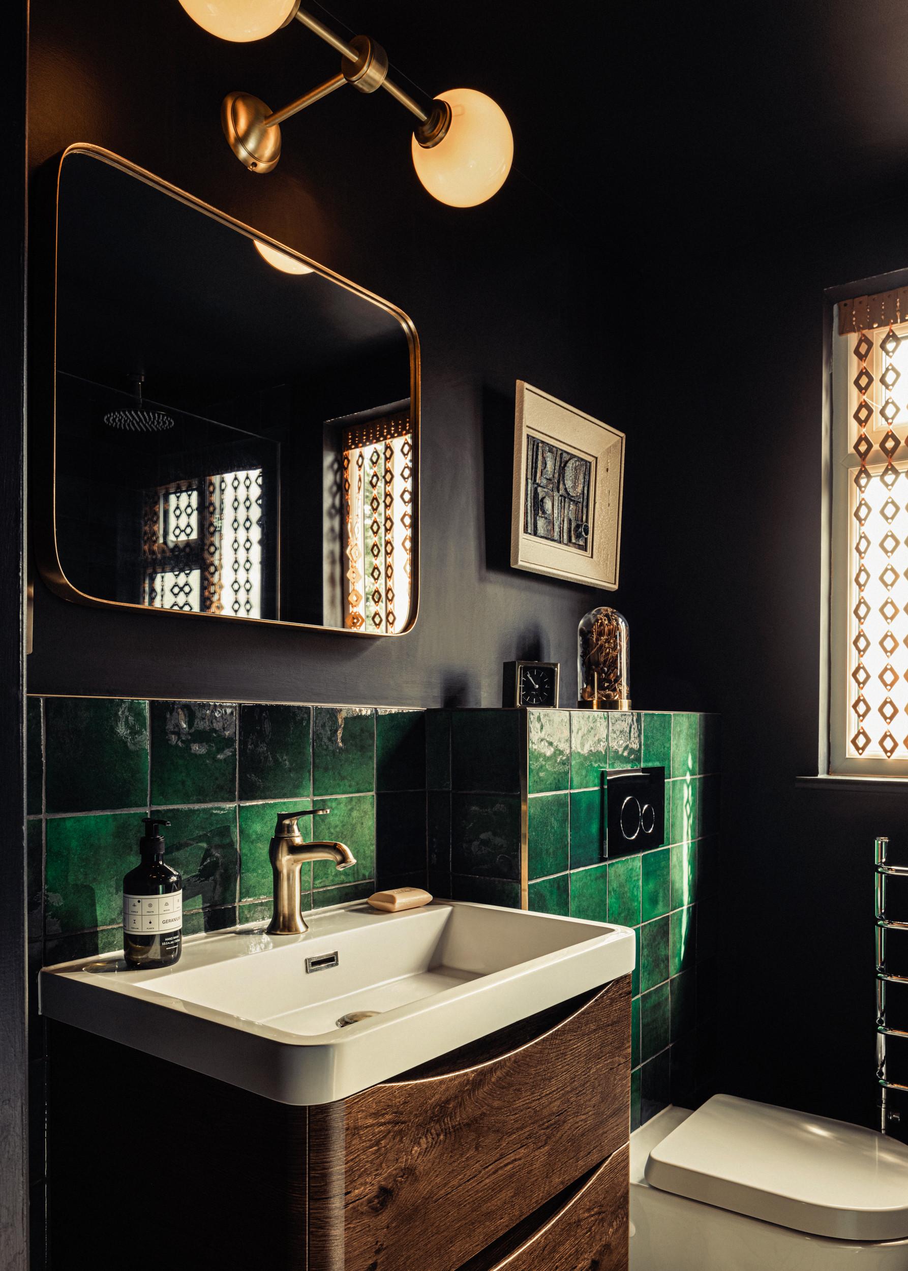 Dark bathroom with green tiles