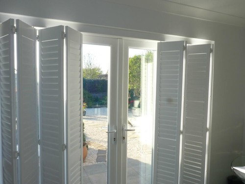 Plantation Shutters Ed On A Track System Are Great Way To