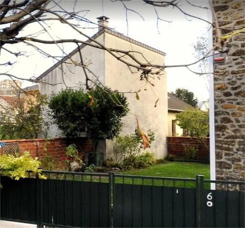 habiller un grand mur dans un jardin. Black Bedroom Furniture Sets. Home Design Ideas