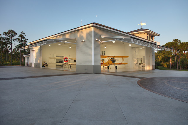 Residential airplane hanger florida vernacular style for Hangar home plans
