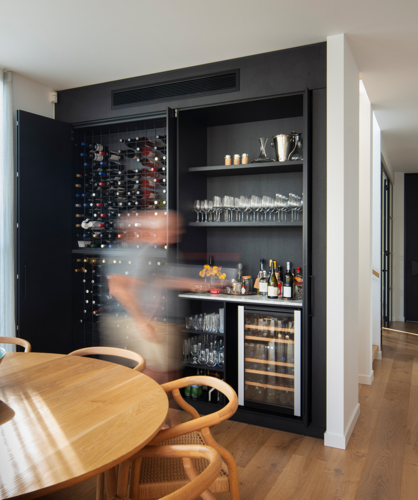 Design ideas for a contemporary home bar in Melbourne.