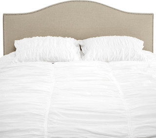 with polished silver nail heads, Z Gallerie's Juliet headboard... more »