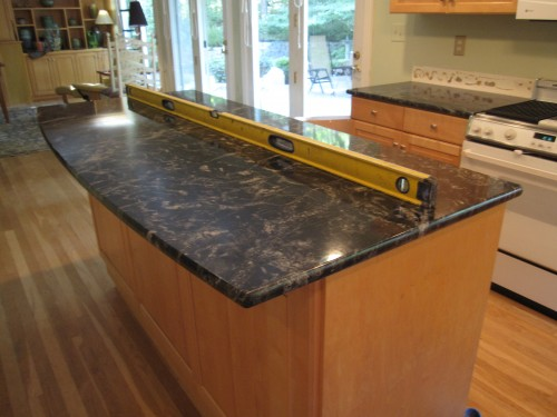 I have black granite countertops and natural maple ... on Backsplash Maple Cabinets With Black Countertops  id=68716