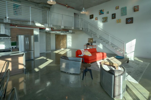 Inspiration for an industrial home design remodel in Miami
