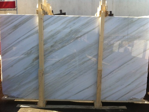can you use calacatta crema marble for kitchen counters .