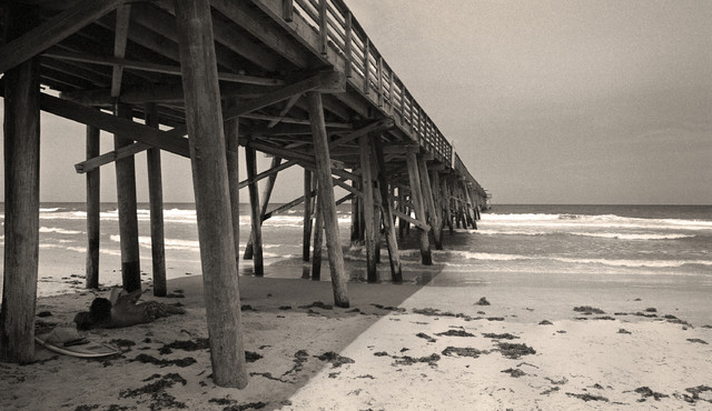 Young lovers flagler beach pier florida fine art black and white photography 1