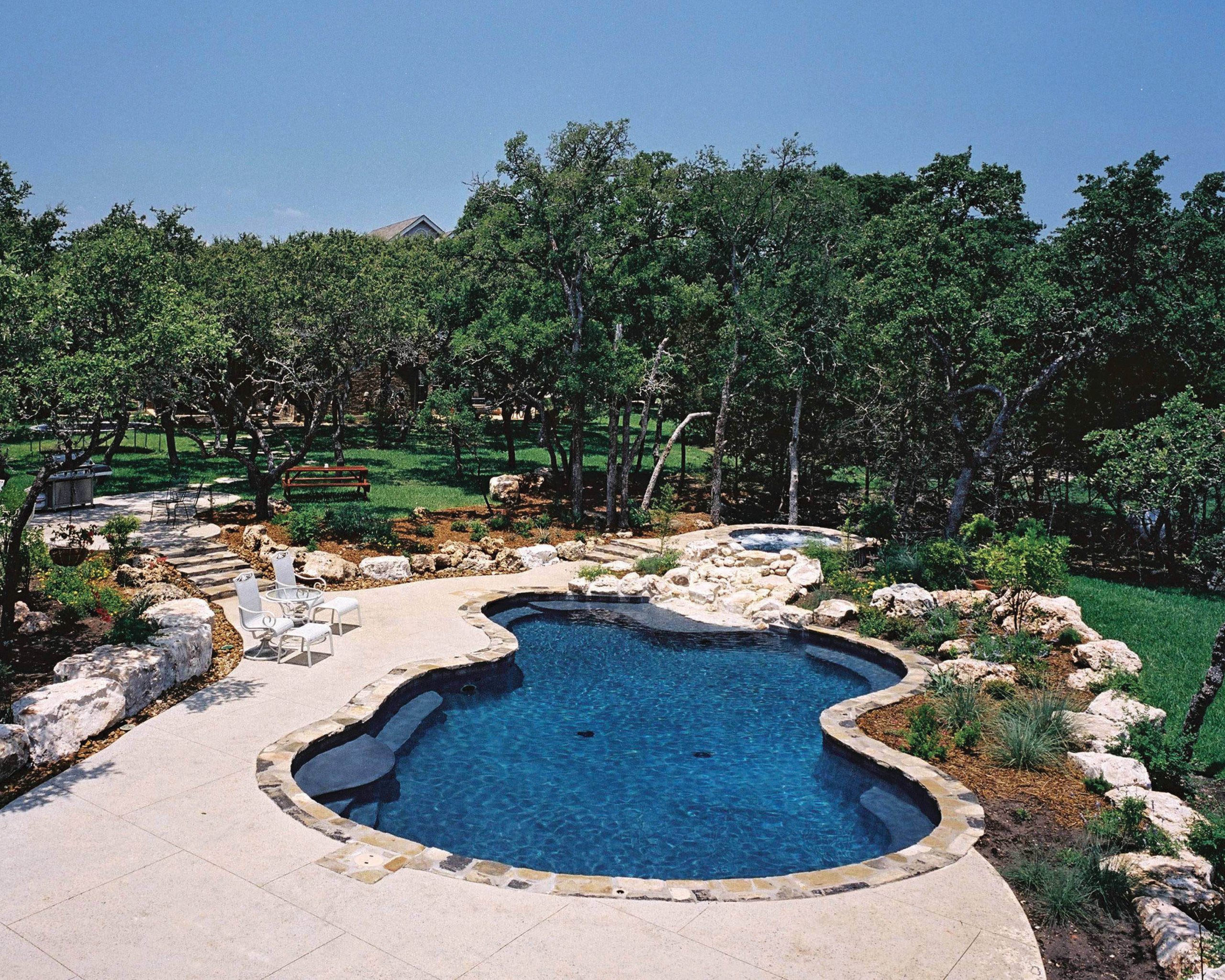 Natural Shape Swimming Pool/Spa Waterfall in Boerne Texas