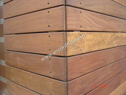 Stone or wood tile cladding for Wooden cladding for exterior walls