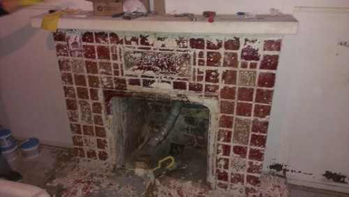 Hi! My wife and I are remodeling a house built in 1920 and one of our projects is restoring the arts and crafts tile fireplace. It