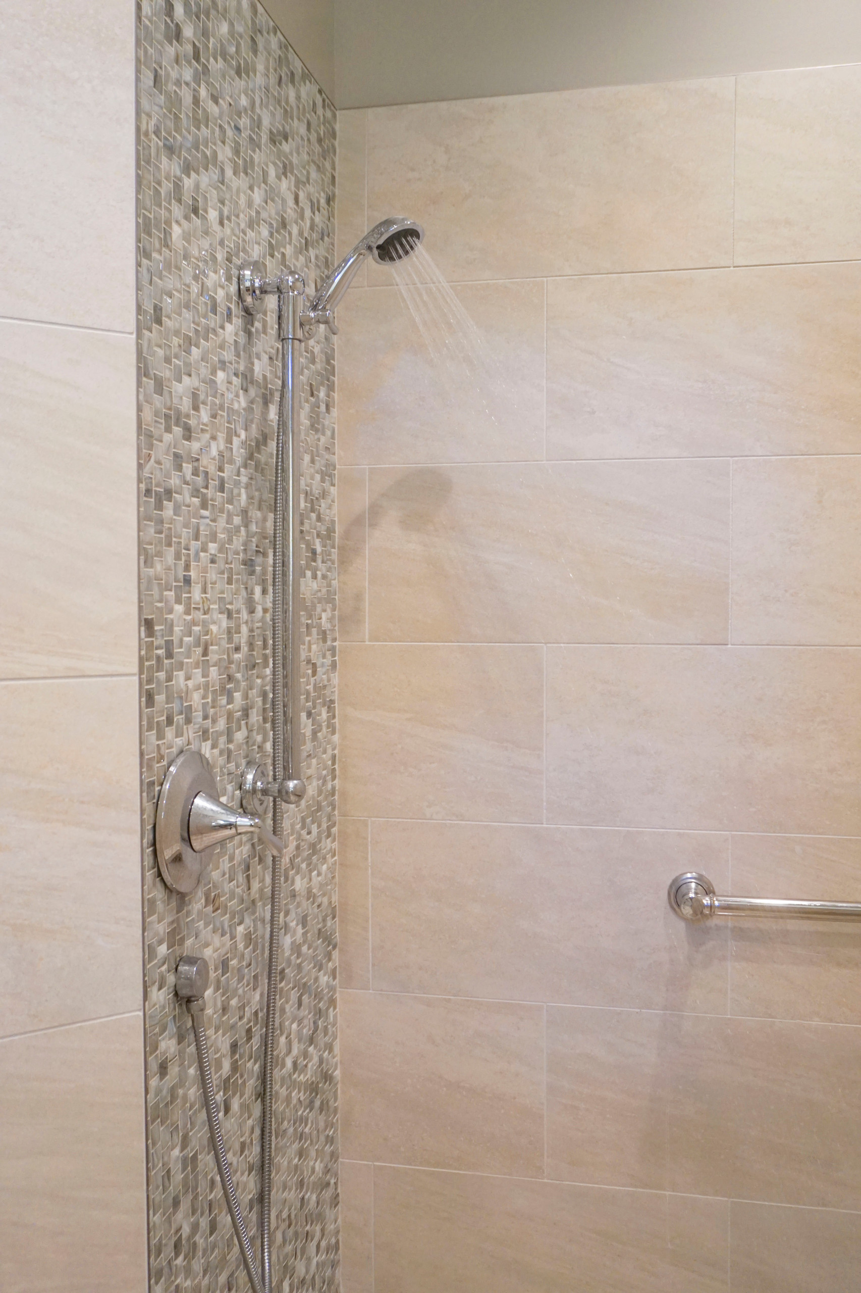 Beautiful accent tile with shower head