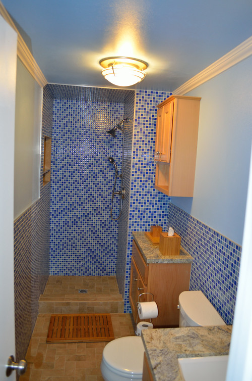 I only need to get the Glass Door for the shower installed and it will be  done. But, you can see the difference already. All the blue tile is glass.