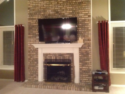 I realize this is an awkward space. The mantle is too small and the TV is too large. I am not a fan of the brick. However