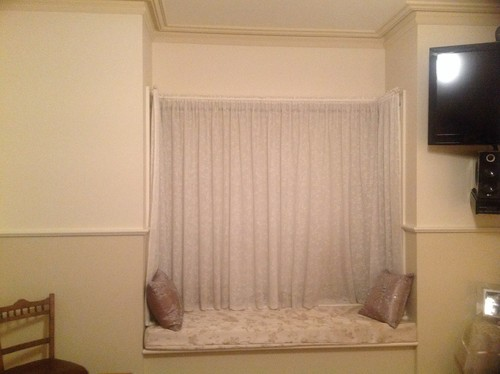 Hanging curtains across a bay window without a bulkhead