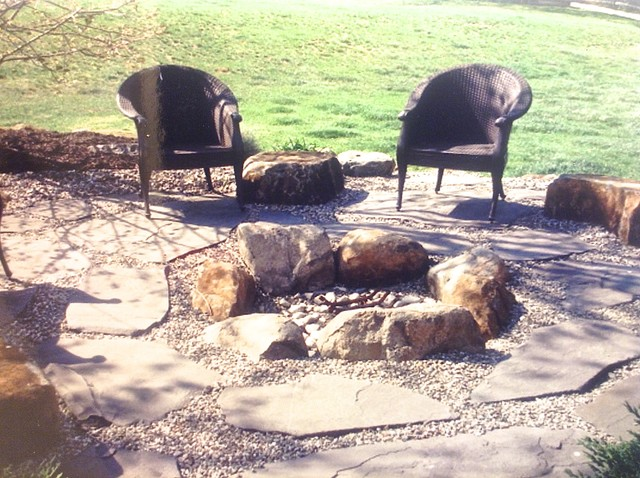 Boulder Fire Pit With Flagstone And Decorative Stone