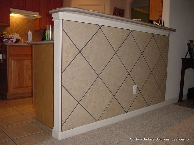 Kitchen under bar kick space tile wall traditional for Traditional kitchen wall tiles