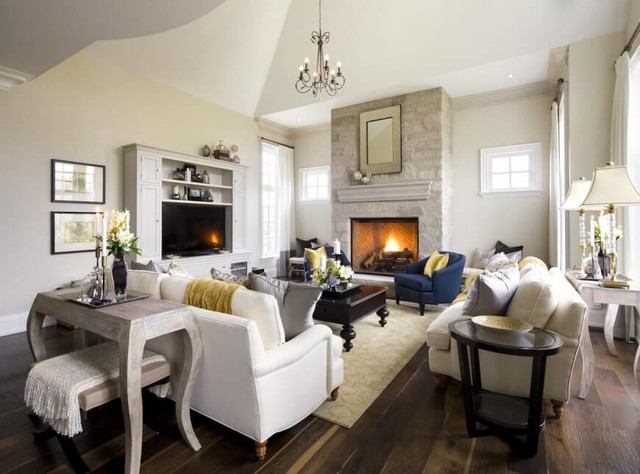 Inspiration for a mid-sized timeless enclosed living room remodel in Other with a standard fireplace and a media wall