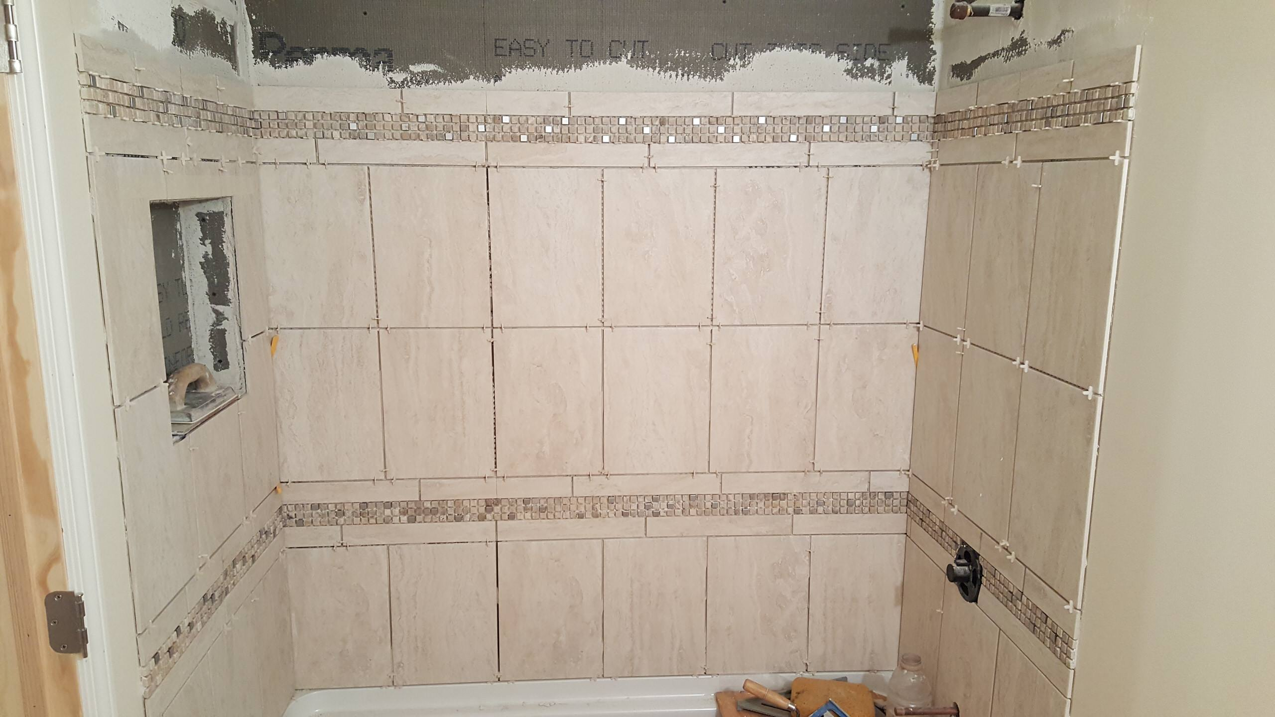 Shower tile getting installed