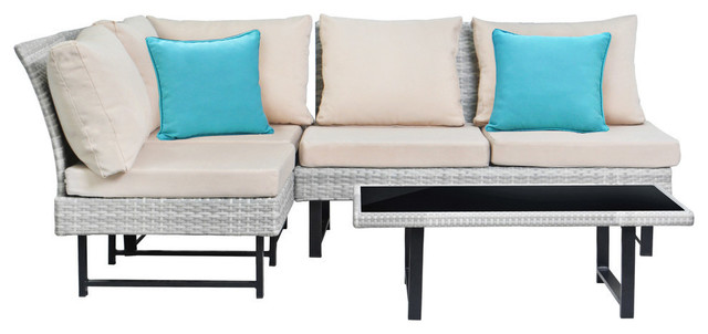 Aleron Ratton Outdoor Sectional And Coffee Table With Teal Accent Pillows.