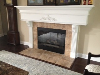 The color of the stone around the fireplace does not work with our decor.    I